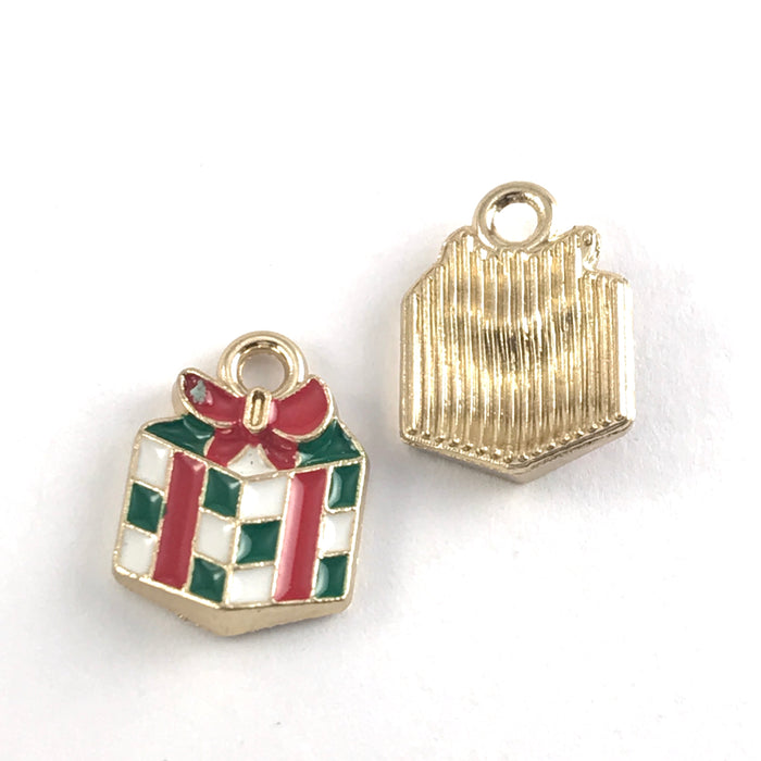 front and back of green white and red jewerly charms shapped like wrapped christmas gifts