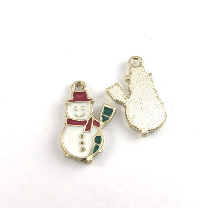 front and back of white red and green jewerly charms that look like snowmen