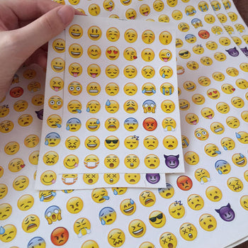 sticker sheets with popular emoji faces on them