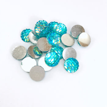 blue cabochons that have the look of fish scales