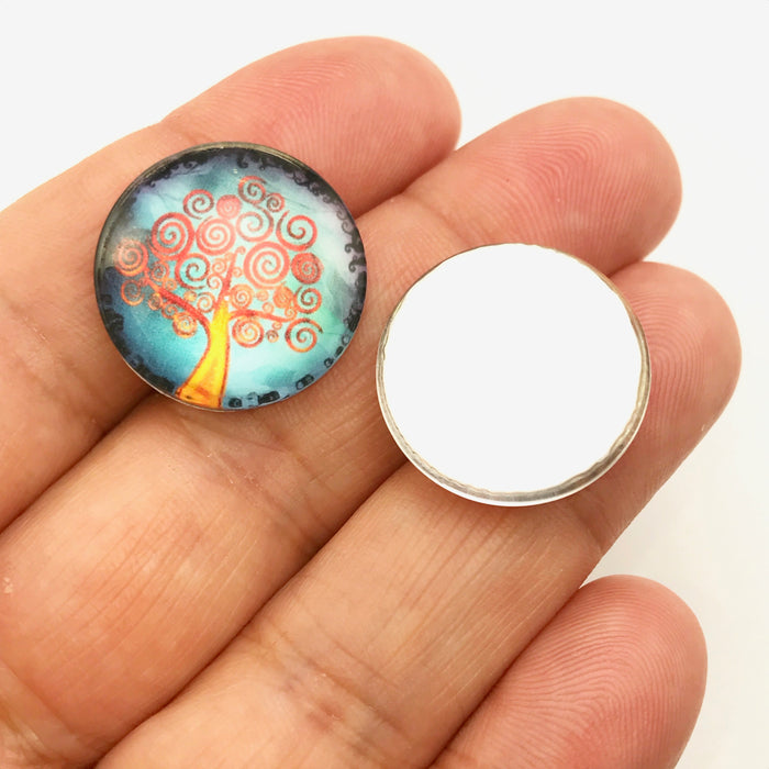 Glass Cabochon with tree design on a hand