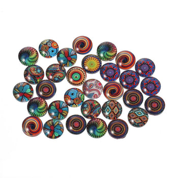 Glass cabochons with brightly coloured designs