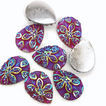 purple teardrop shaped cabochons with flower embellishments