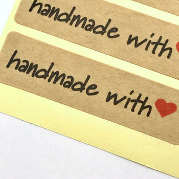close up of craft paper sticker with handmade with heart on it