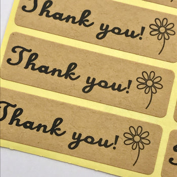 close up of craft paper sticker with Thank You printed on them