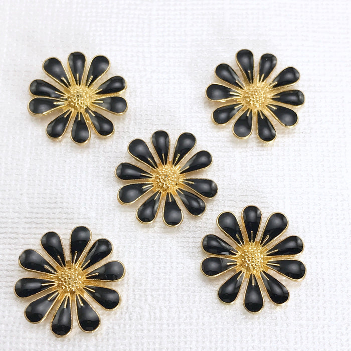 5 black and gold daisy shaped jewelry embellishments