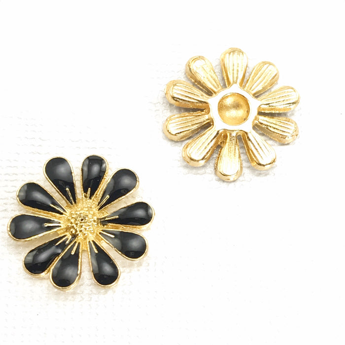 Fron and back of black and gold daisy shaped jewelry embellishments