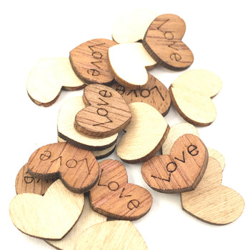 heart shaped wood pieces with the word love engraved on them