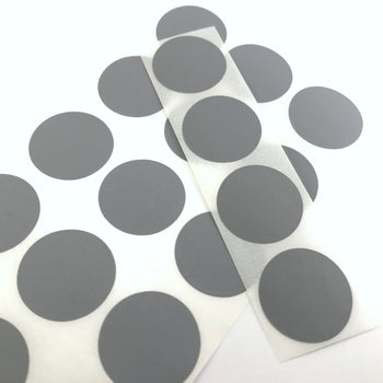 round grey stickers on a sheet