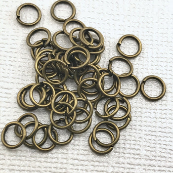 Pile of bronze open jump rings