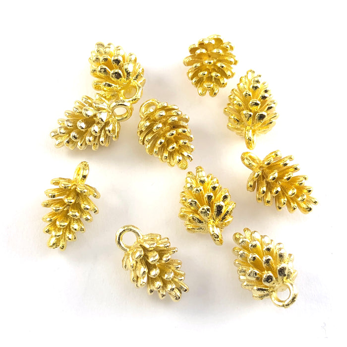 gold colour jewerly charms that look like pine cones