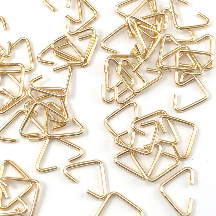 gold colour triangle shaped jump rings
