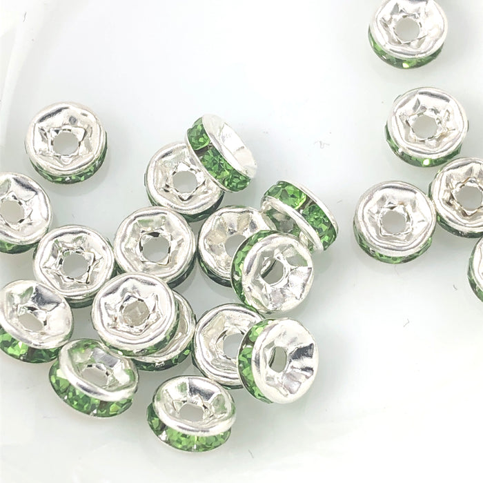 silver rondelle shaped beads with green rhinestones