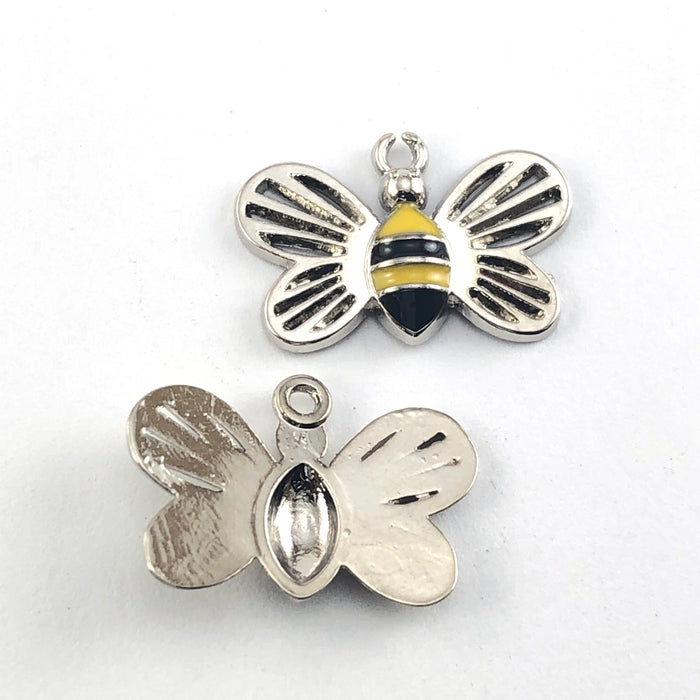 front and back of bee shaped charms that are silver, black and yellow