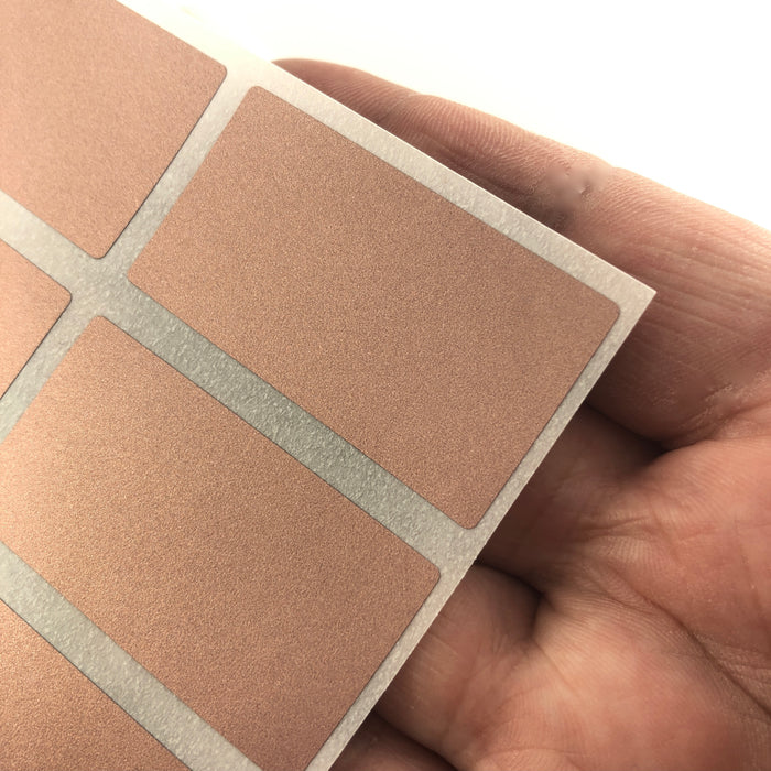 rose gold rectangle stickers on a hand to show scale