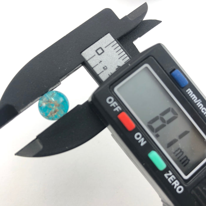 blue and clear round beads on a digital ruler that reads 8.1mm