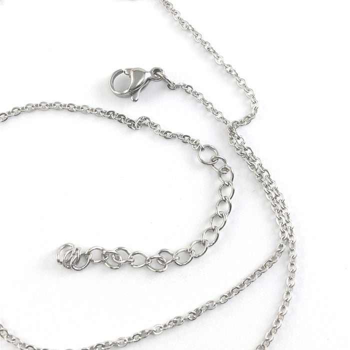 close up of clasp on a silver colour necklace chain
