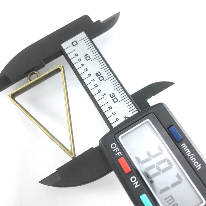 bronze triangle shaped open bezels on a digital ruler that reads 38.7mm