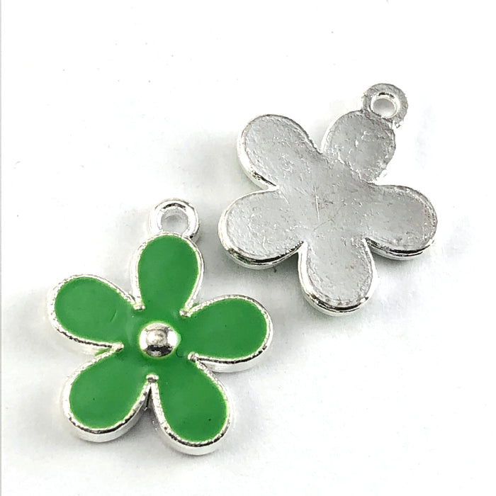 front and back of green and silver flower shaped jewerly charm