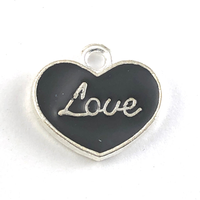 heart shaped black and silver charms with the word love on them