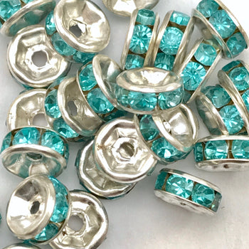 pile of silver and aqua color rondelle jewelry beads
