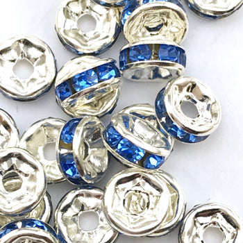 pile of silver and cobalt blue color rondelle jewelry beads
