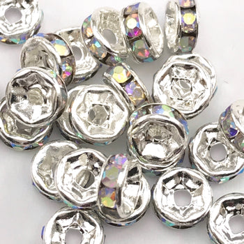 pile of silver and Crystal AB color rondelle jewelry beads