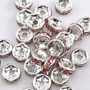 pile of silver and pink color rondelle jewelry beads