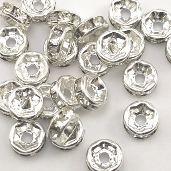 pile of silver and clear color rondelle jewelry beads