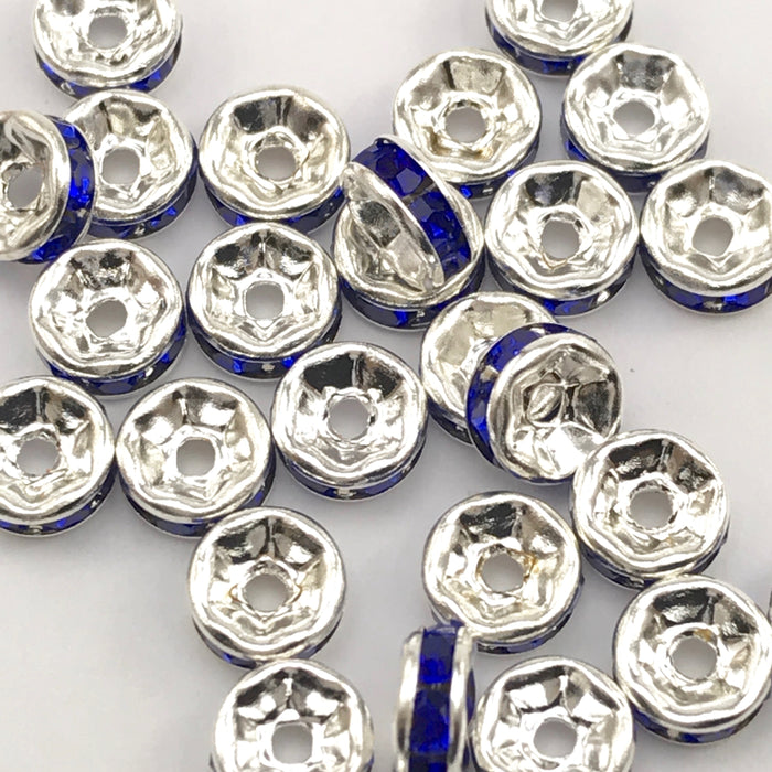 pile of silver and blue color rondelle jewelry beads