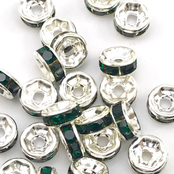 pile of silver and green color rondelle jewelry beads