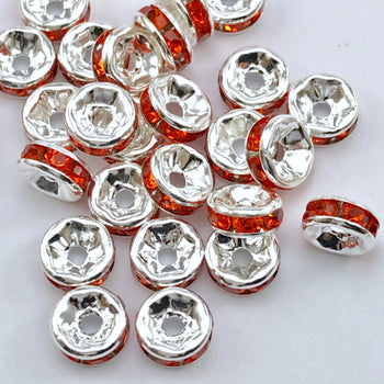 pile of silver and orange color rondelle jewelry beads