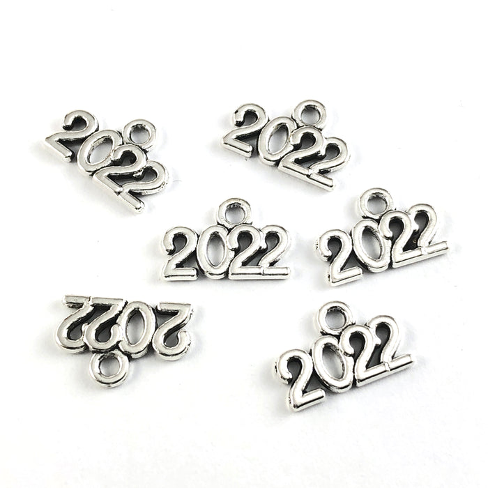 silver jewerly charms in the shape of 2022