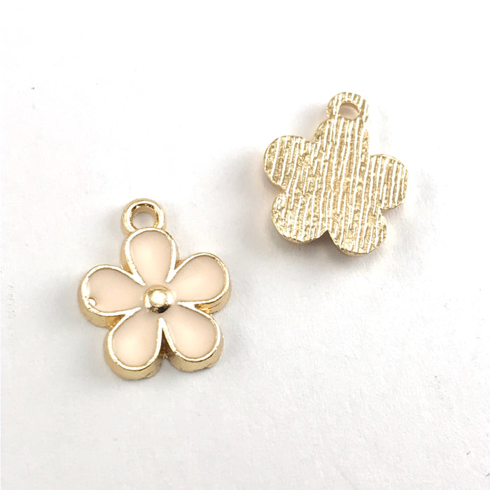 front and back of pink and gold flower shaped jewerly charms