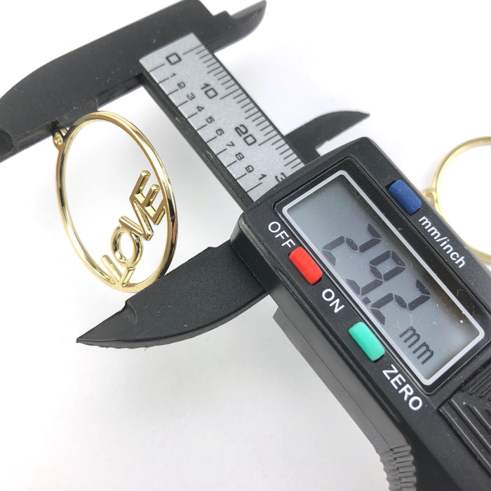 round open back bezels that have the word love in them, on a digital ruler that reads 29.2mm