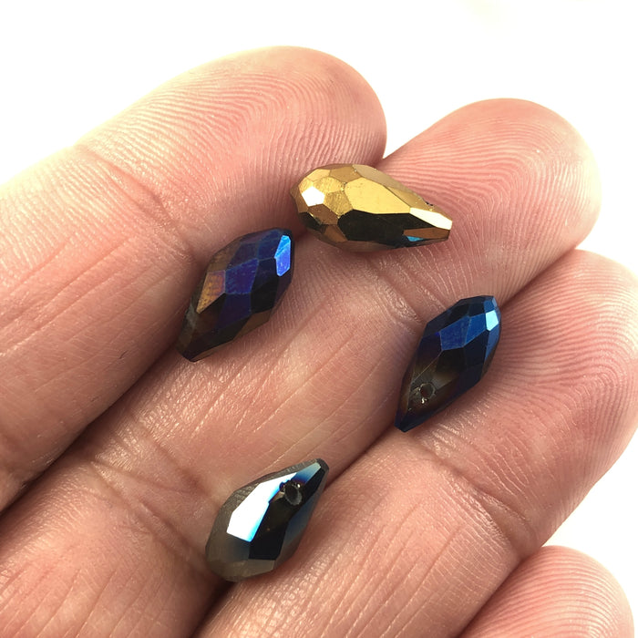 teardrop shaped beads in mixed colours, sitting on a hand to show scale