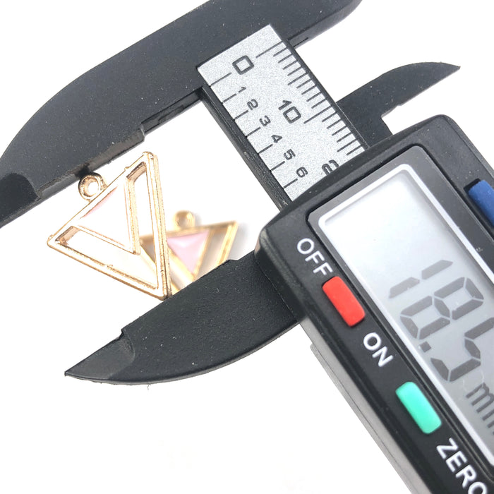 pink and gold triangle shaped jewerly charms on a digital ruler that reads 18.5mm