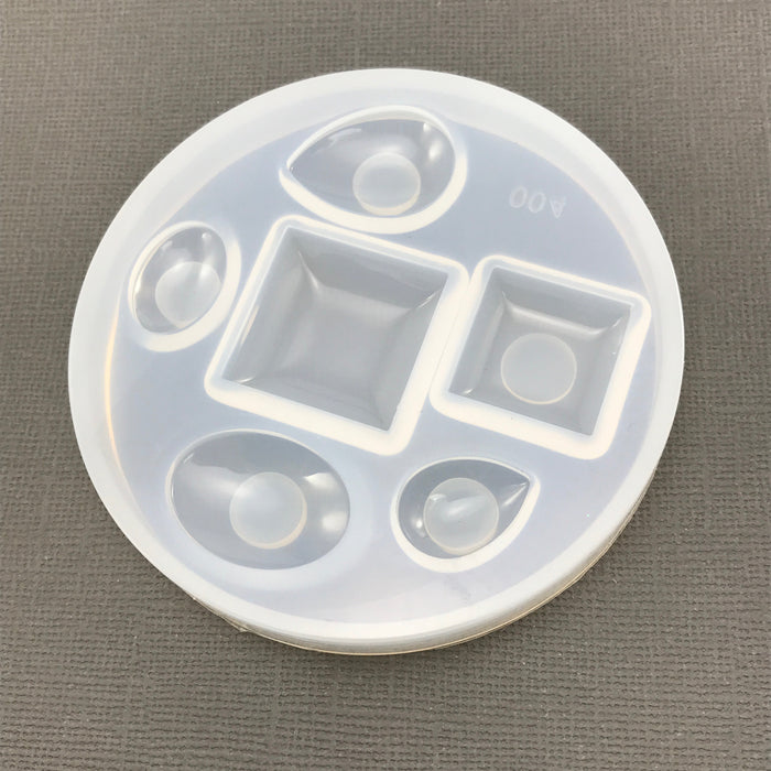 clear silicone mold with six pendant shaped holes
