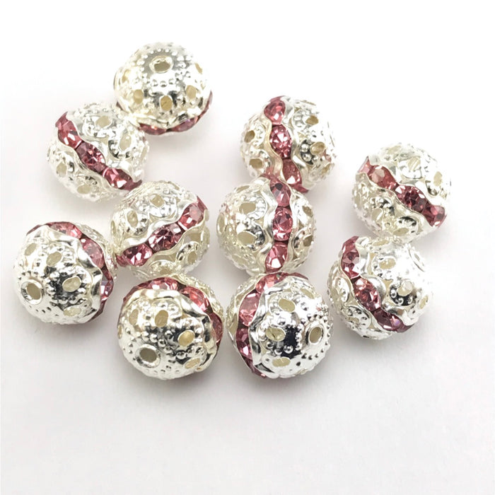 round silver beads with pink rhinestones