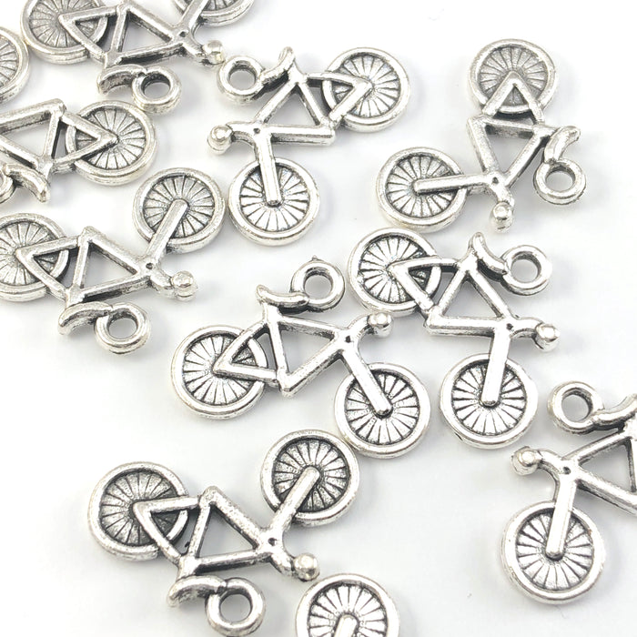bicycle shaped jewerly charms in an antique silver finish
