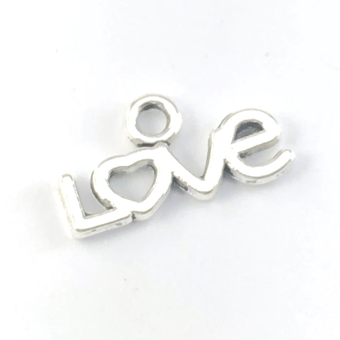 silver colour charm that in the shape of the word love