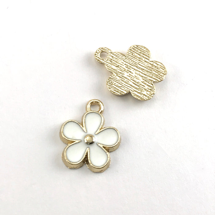 front and back of white and gold flower shaped jewelry charms