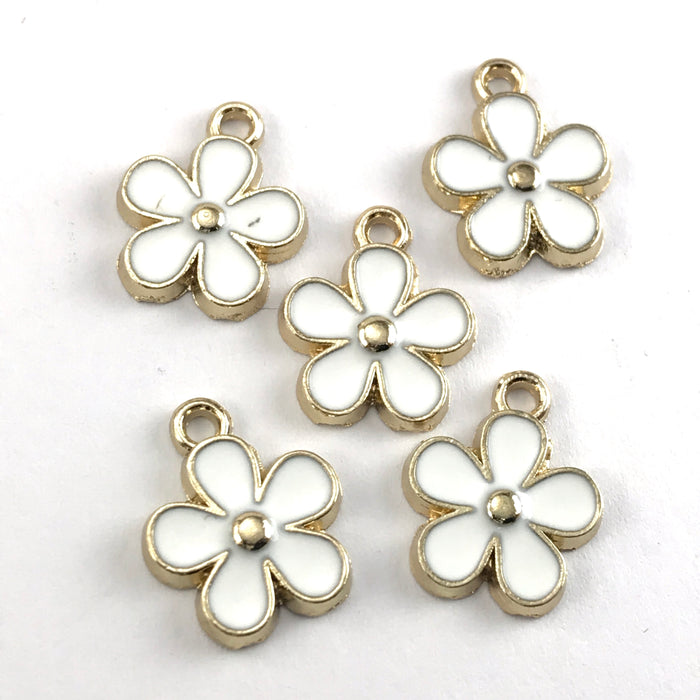 white and gold flower shaped jewelry charms