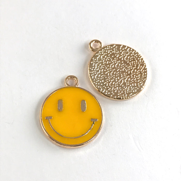 front and back of yellow and gold round flat jewerly charms that have a smiley face on them