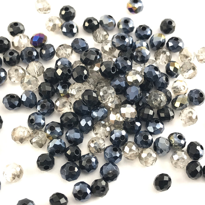 rondelle shaped jewerly beads that are a mix of black grey and clear