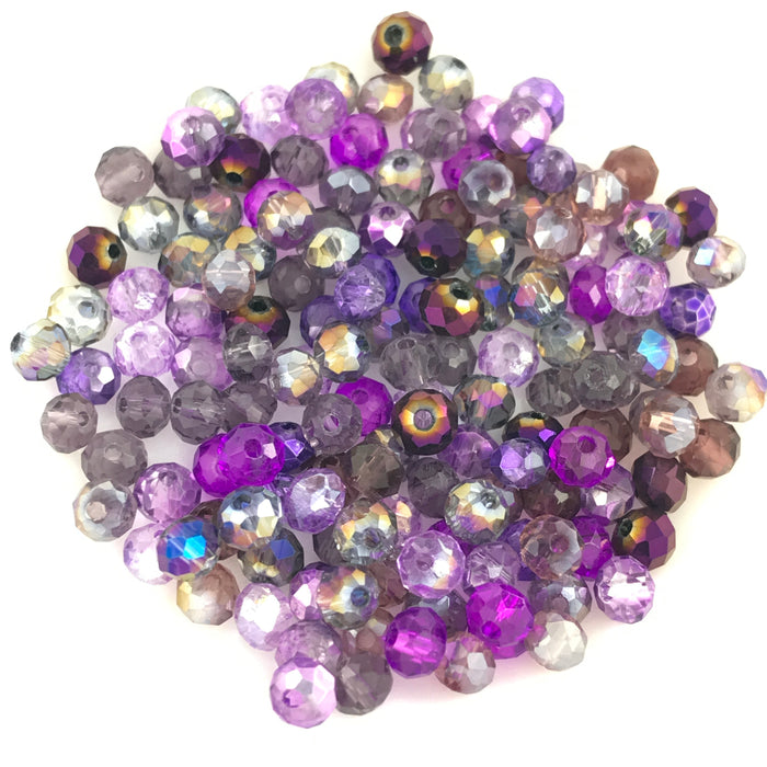 rondelle shaped jewerly beads that are a mix of purple colours