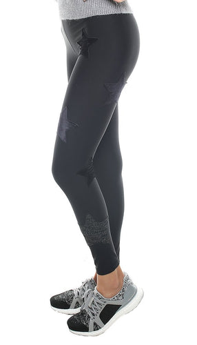 Leggings in lycra nero con stelle applicate di velluto nero e in lurex nero