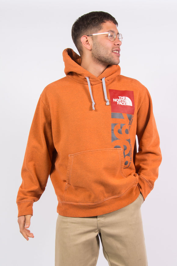 The North Face orange hoodie.