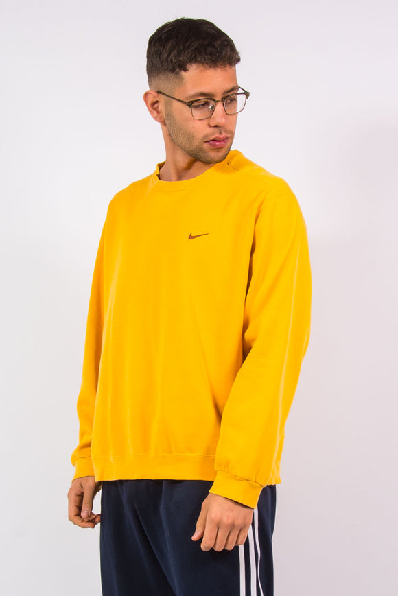 90's vintage Nike yellow crew neck sweatshirt with embroidered logo on chest