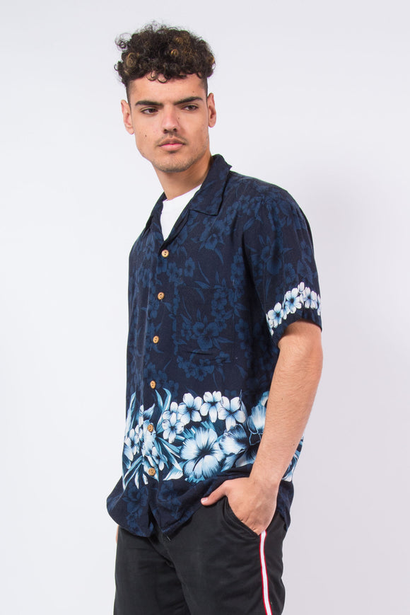Vintage 90's navy blue Hawaiian style floral print shirt.